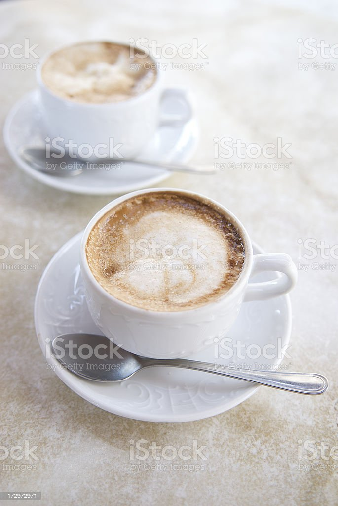 Two Cappuccinos on Marble Counter royalty-free stock photo