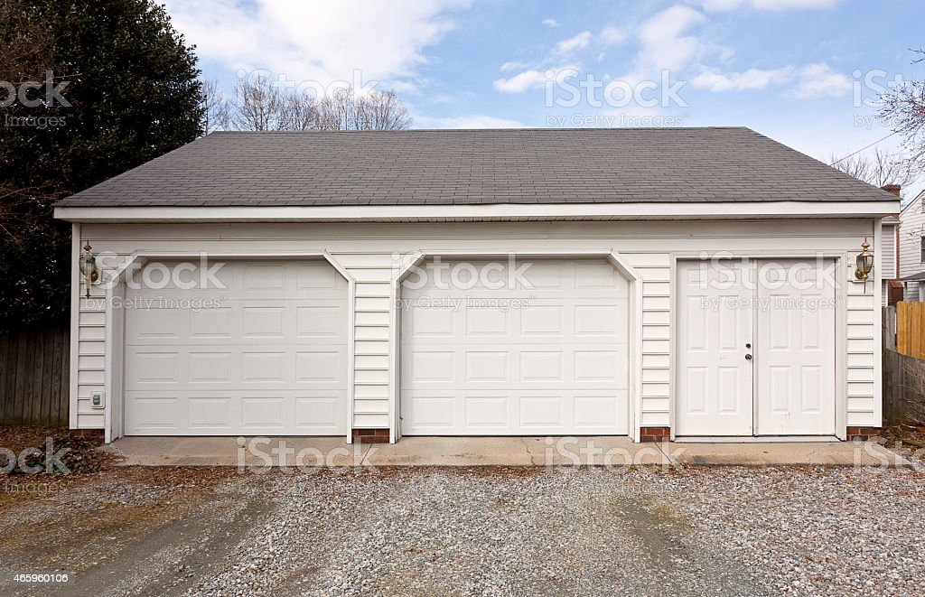 Captivating Two Car Garage With Gravel Driveway Royalty Free Stock Photo