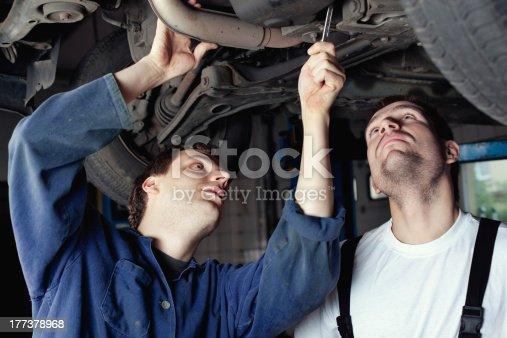 154934986 istock photo Two Car Mechanic repairing automobile 177378968
