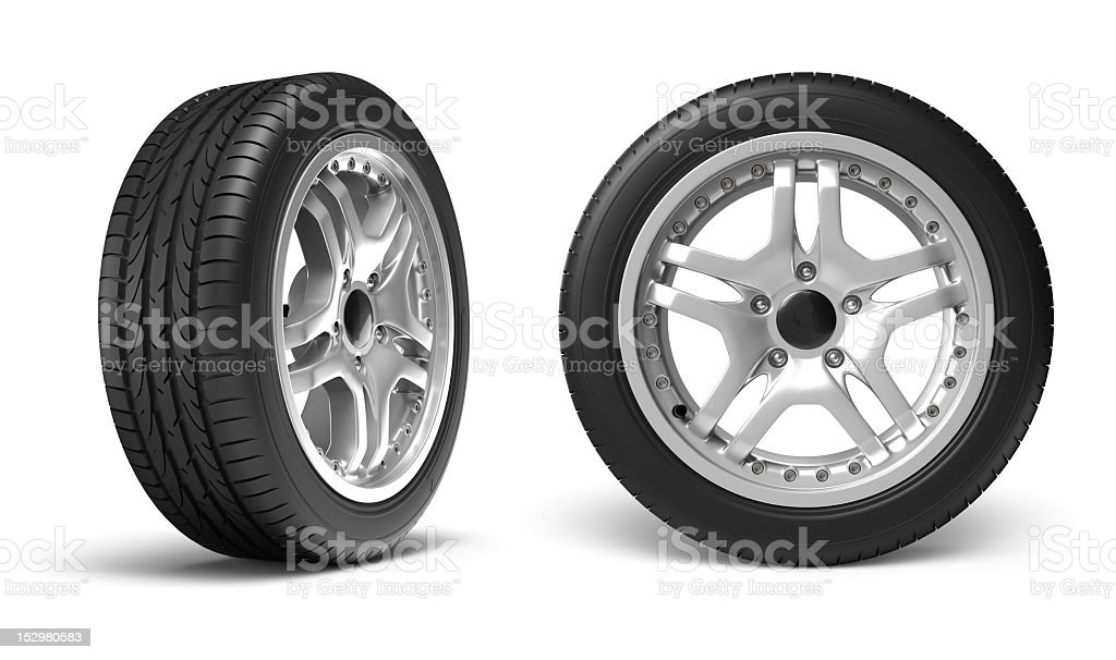 Two car wheels standing vertically with white backdrop stock photo
