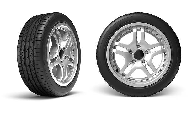 two car wheels standing vertically with white backdrop - 車輪 個照片及圖片檔
