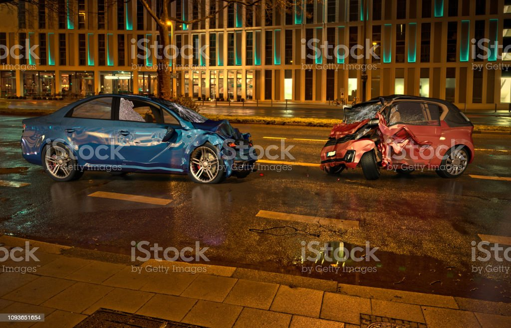 Two cars accident. Crashed cars on the road on city location at night...
