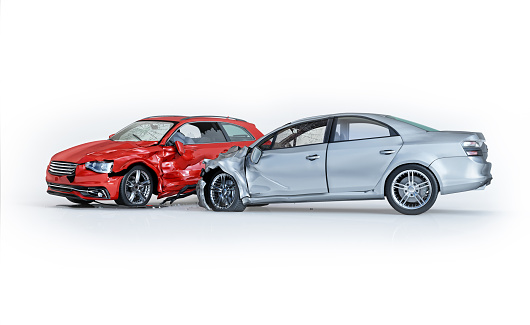 istock Two cars accident. Crashed cars. One silver sedan against one red coupé. 1093650952