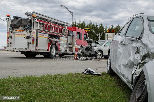 Two cars crashed in accident with firetruck behind during a day of summer