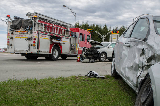 two cars crashed in accident with firetruck behind - car accident stock photos and pictures