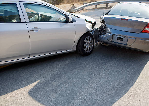 Two cars in collision on roadway  misfortune stock pictures, royalty-free photos & images