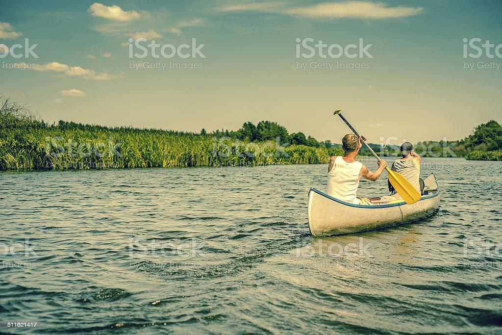 Two caucasian boys in a canoe stock photo