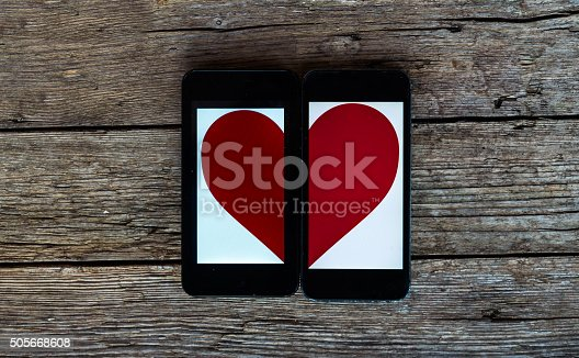 Two Cellphones With Half Heart Symbol Stock Photo More Pictures Of