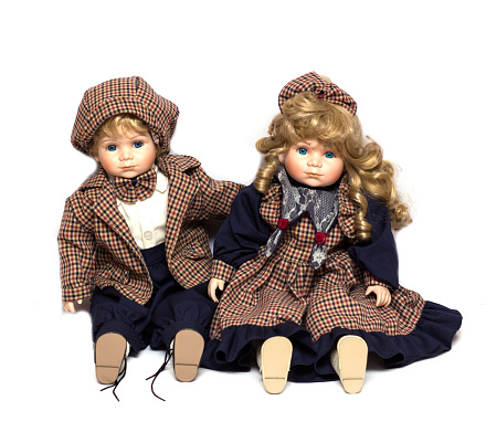 Two ceramic gardeners dolls sitting on white background.