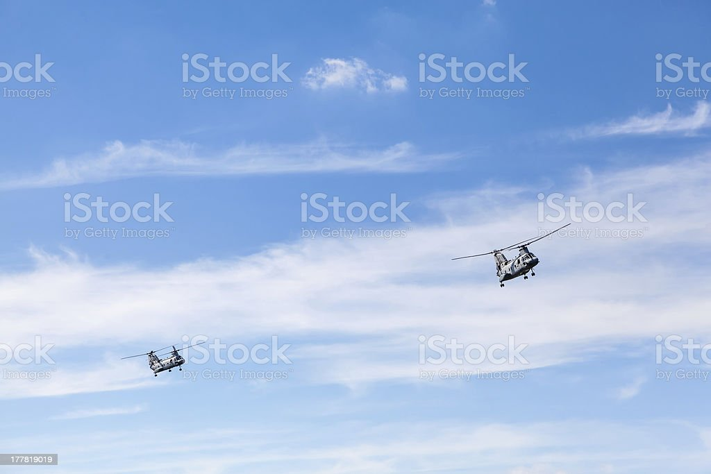 Two CH-46 Chinook Helicopters Flying stock photo