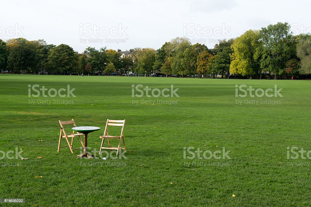 Two chairs and a table on the meadow stock photo