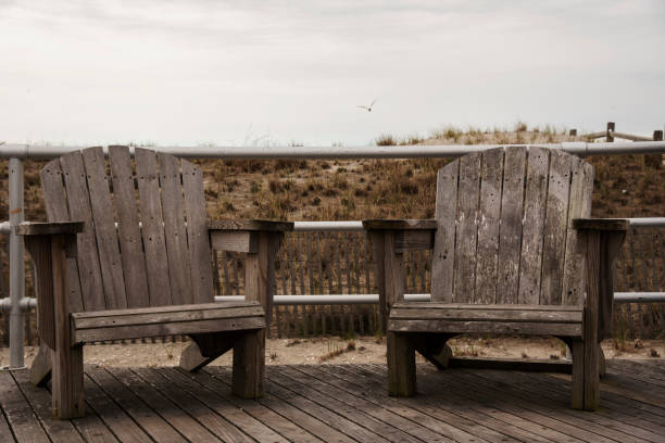 Two chairs on Atlantic City boardwalk. New Jersey stock photo