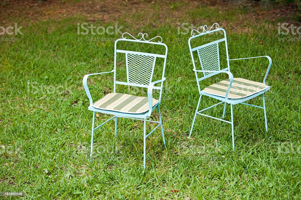 Two chairs on grass stock photo