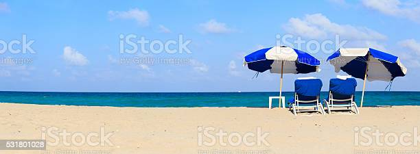 Two chairs on sand beach