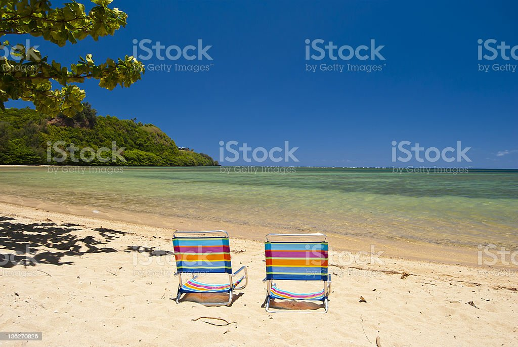 Two chairs on the beach stock photo