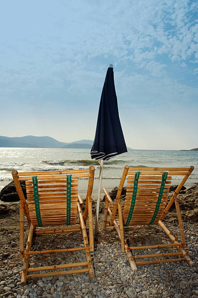 two chairs on the beach - dawdle stock pictures, royalty-free photos & images