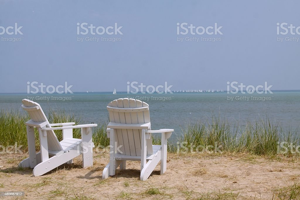 Two Chairs On The Shores of Lake Michigan stock photo