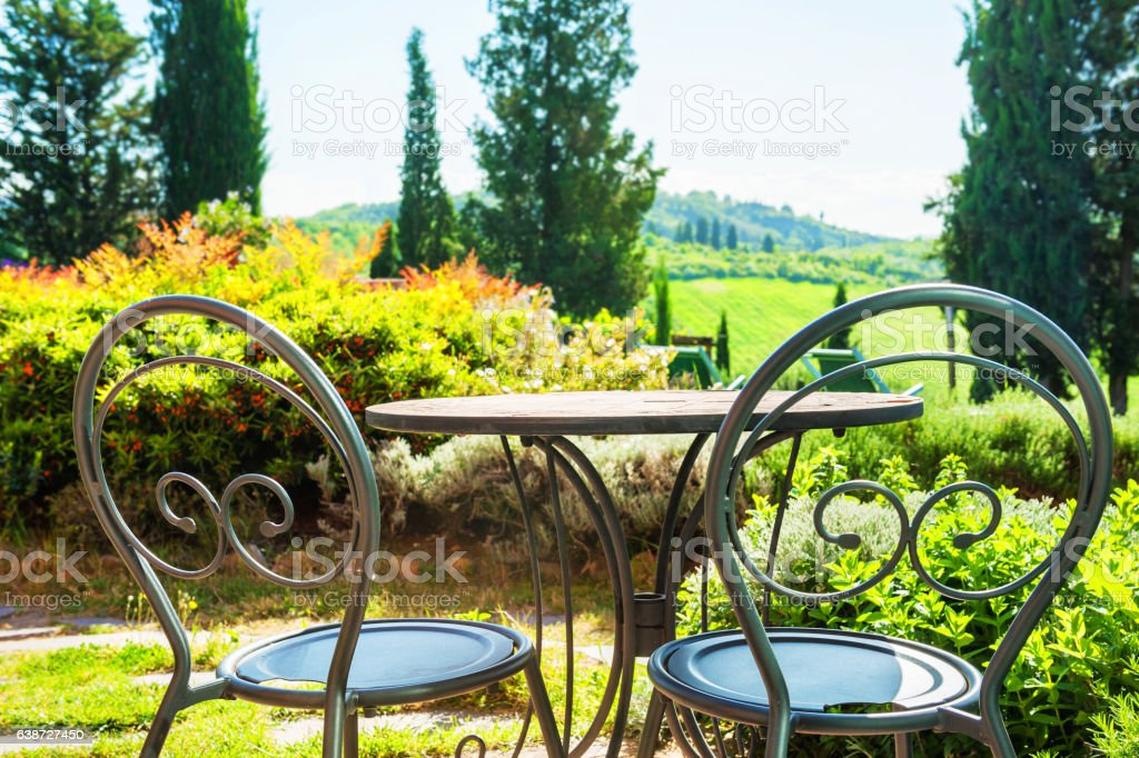 Two chairs on the terrace of a country house stock photo