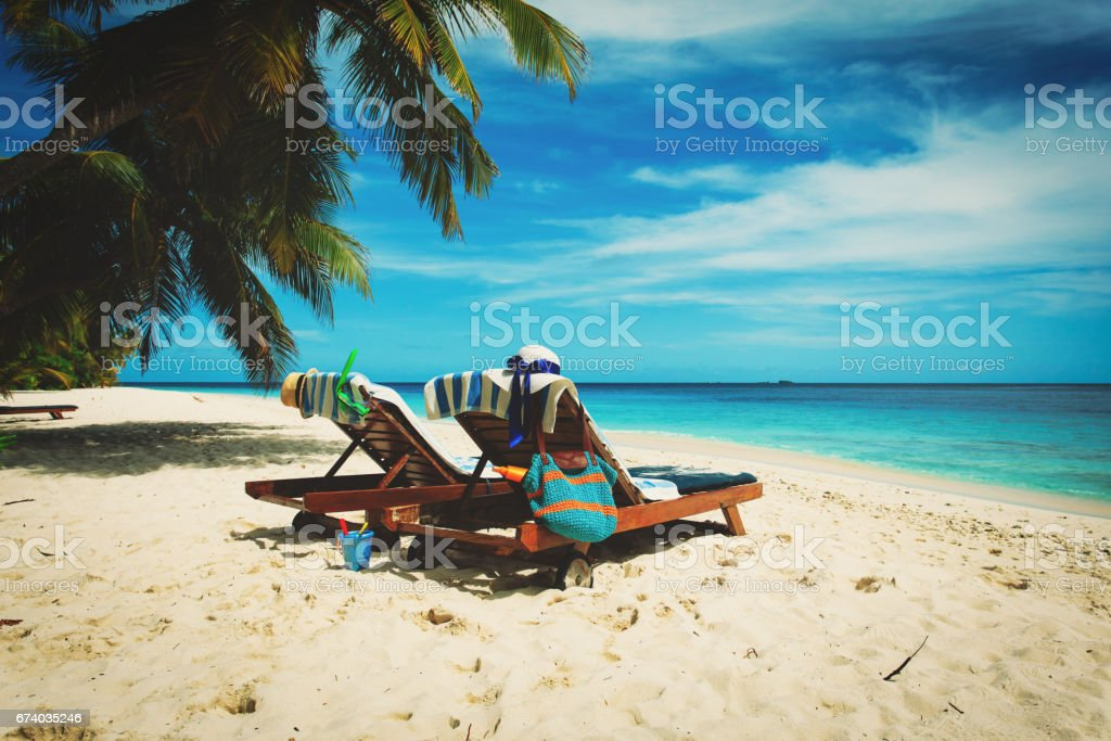 Two chairs on the tropical beach royalty-free stock photo
