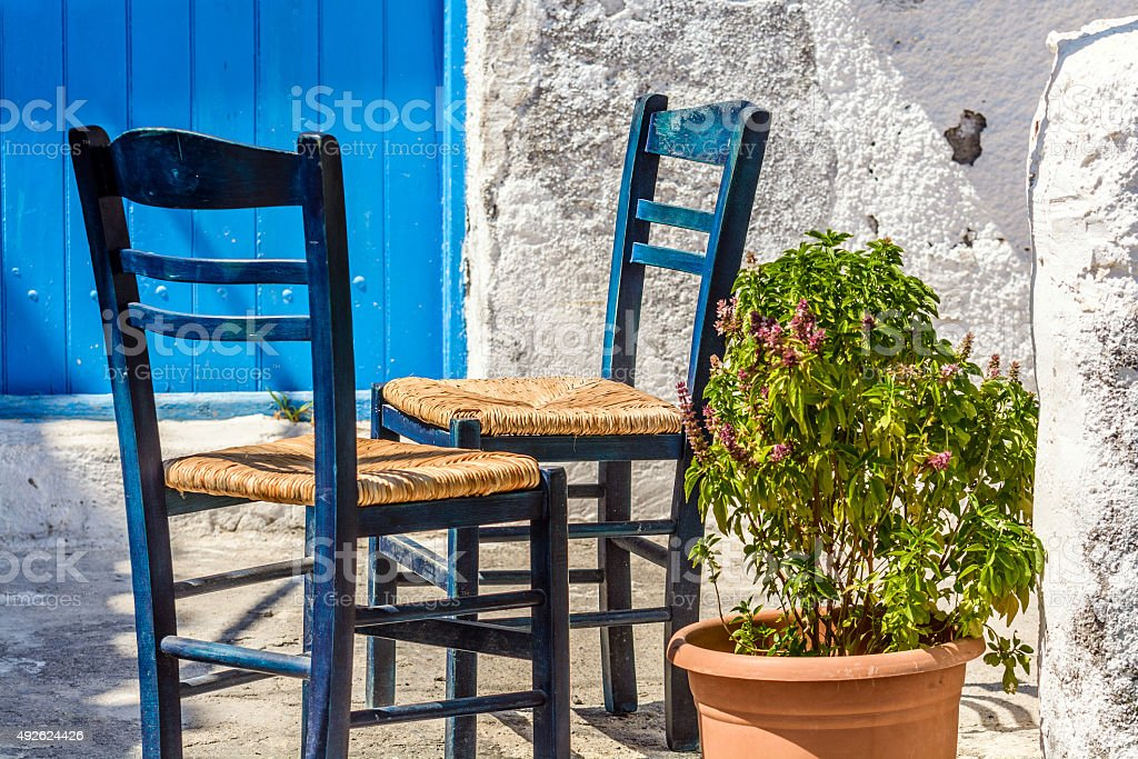 Two chairs outside a Greek home stock photo