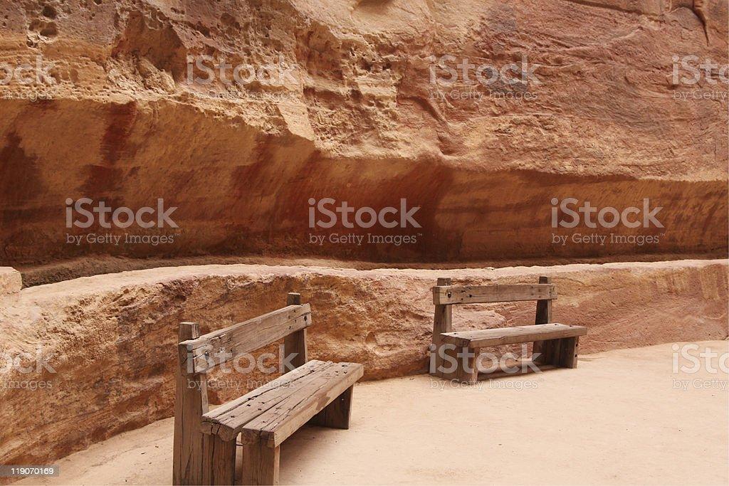 Two chairs sit in the siq Petra Jordan stock photo