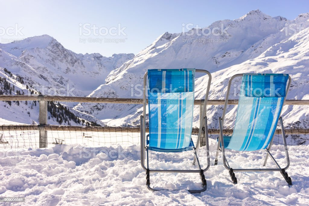 two chairs with a view over some mountains stock photo