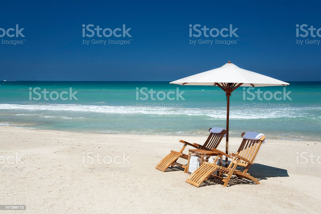 two chairs with umbrella on a beach in Florida stock photo