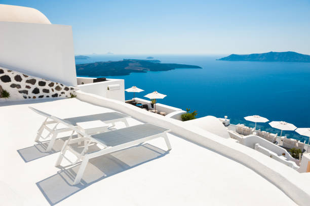 Two chaise lounges on the terrace with sea view. Santorini island, Greece - foto stock