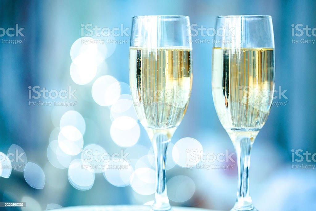 Two champagne glass on christmas bokeh background stock photo