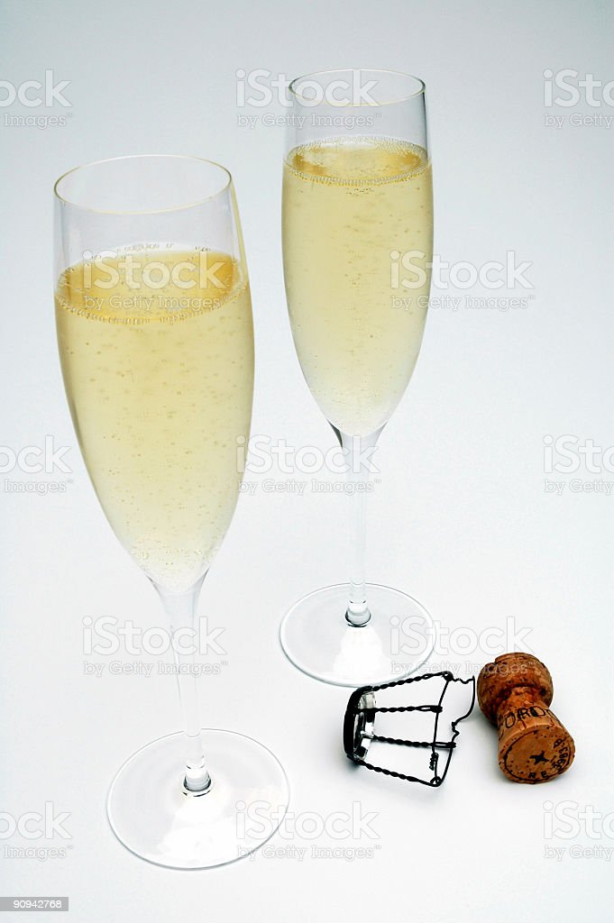 Two champagne glasses against white background royalty-free stock photo