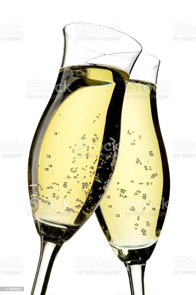 Two champagne glasses being toasted royalty-free stock photo