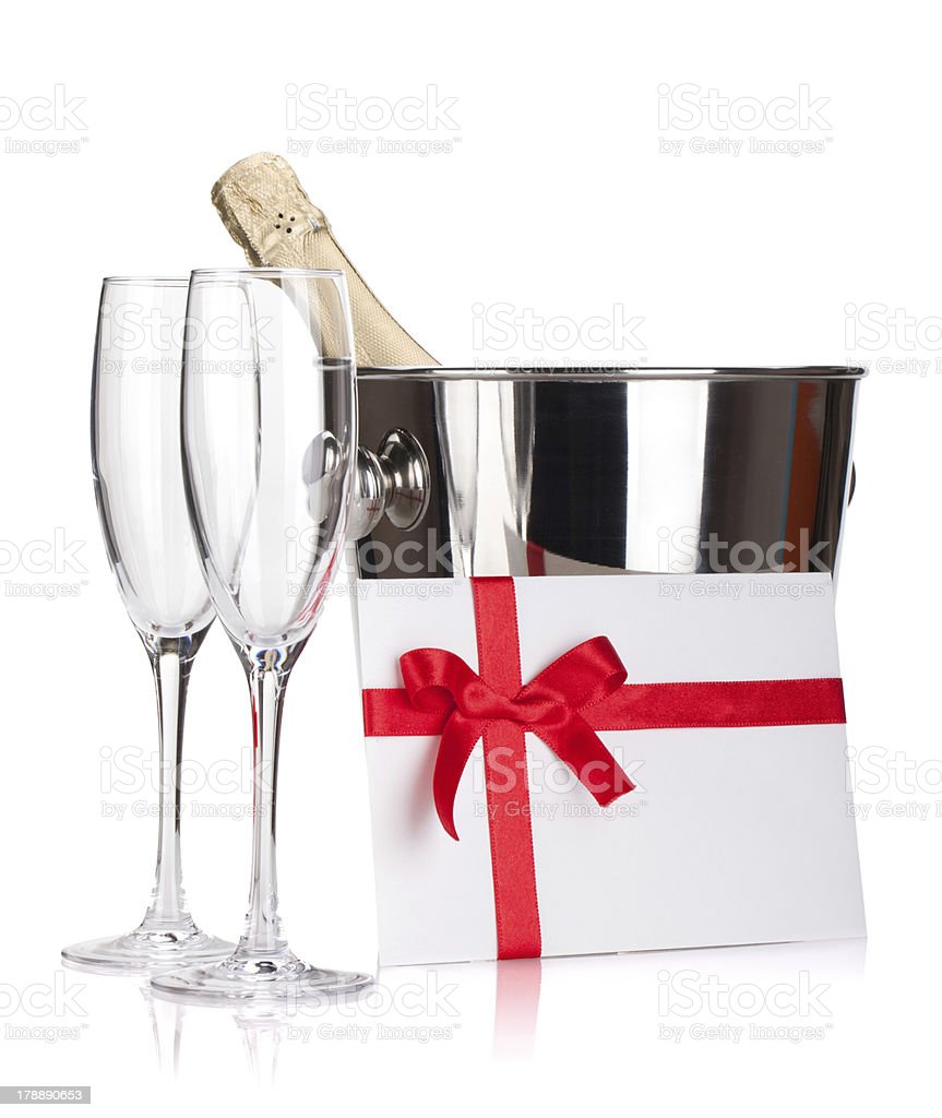 Two champagne glasses, bottle in bucket and letter royalty-free stock photo