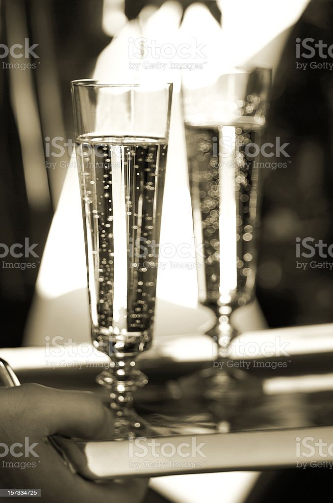 Two Champagne glasses on tray stock photo