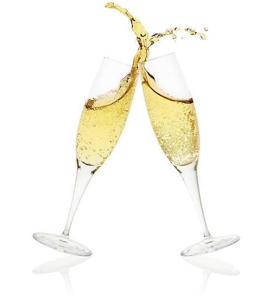 two champagne glasses toasting on white background - sektglas stock-fotos und bilder