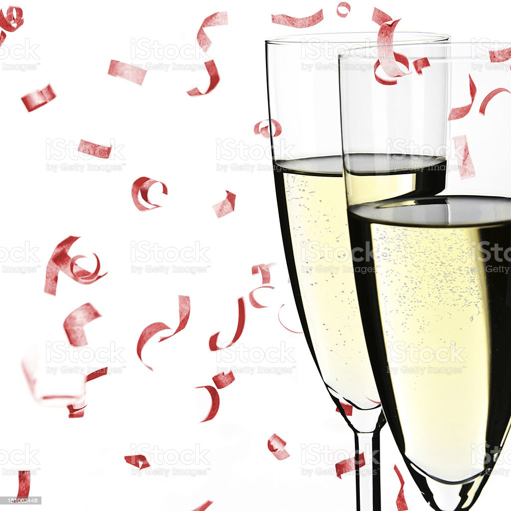 Two Champagne glasses with bubbles, falling confetti, isolated on white royalty-free stock photo