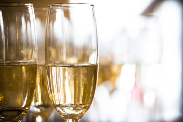 Two champagne glasses with sparkling golden wine stock photo