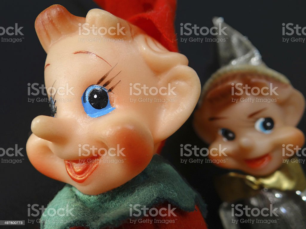 Two cheerful elf puppets stock photo