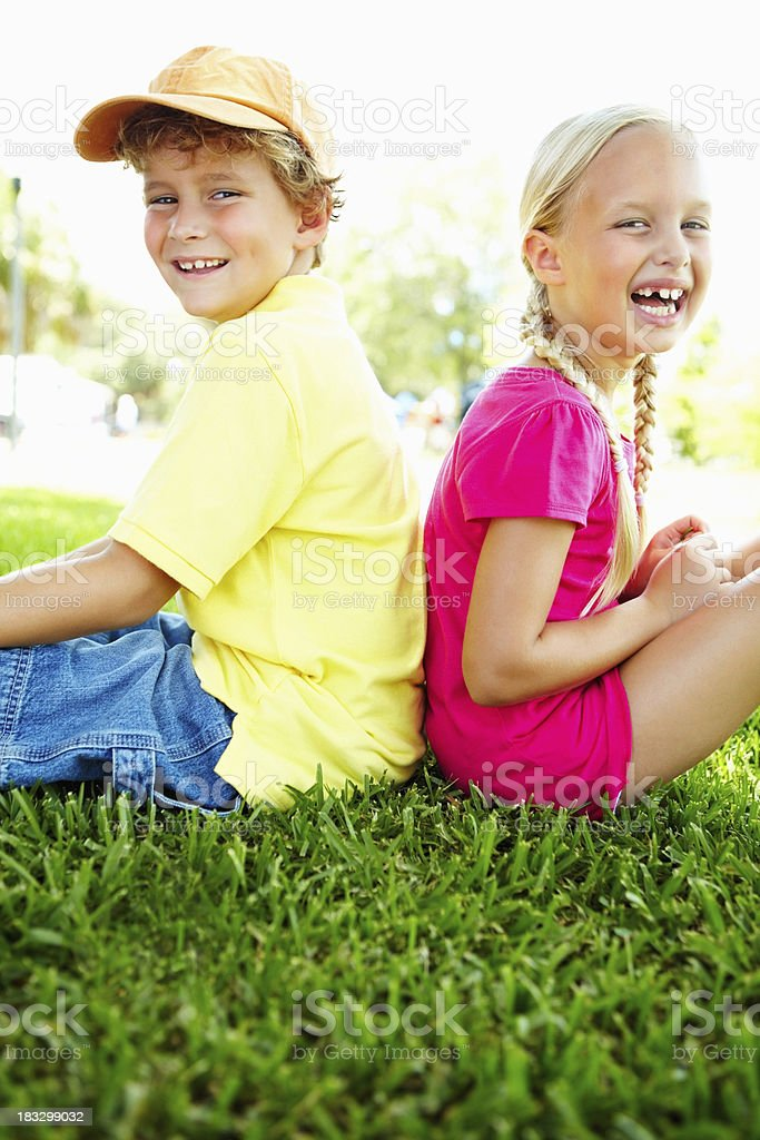 Two cheerful friends spending time together in park royalty-free stock photo