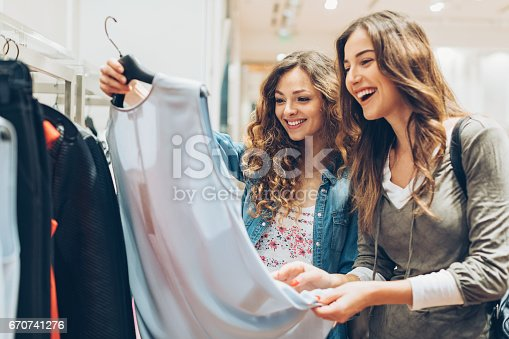 Two young women in the fashion store