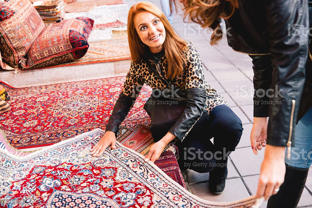Two Cheerful Women Buying Carpets stock photo