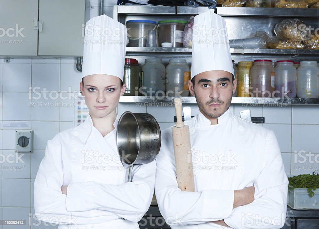 Two chef's in the kitchen stock photo