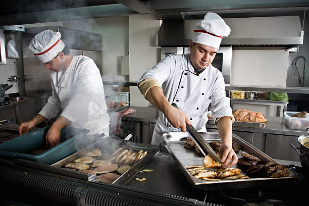 two chefs - busy restaurant kitchen stock pictures, royalty-free photos & images