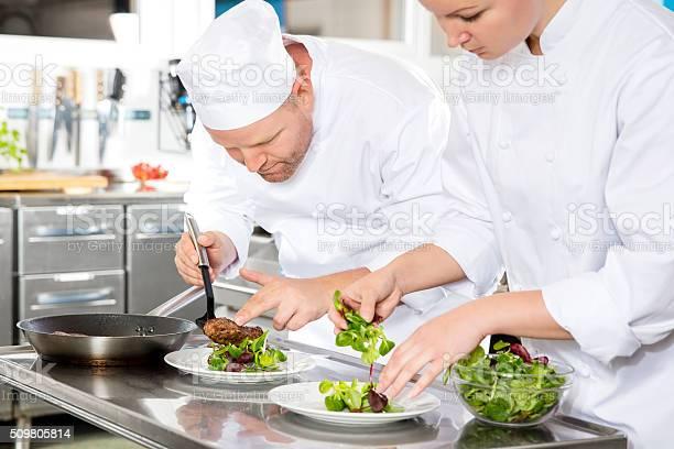 Two chefs prepares steak dish at gourmet restaurant picture id509805814?b=1&k=6&m=509805814&s=612x612&h=4lgmouf9wbqxfsk2wve0fwameadu9hwkaws grzhhgw=