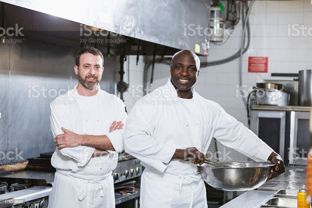 Two chefs working in a commercial kitchen stock photo
