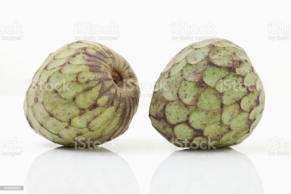 Two cherimoya on white background stock photo