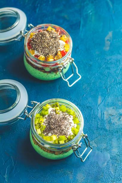Two chia seed pudding with matcha green tea stock photo