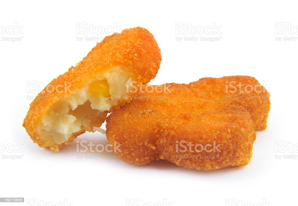 Two chicken nuggets with a bite taken out royalty-free stock photo