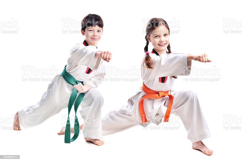 Two children athletes martial art taekwondo training stock photo