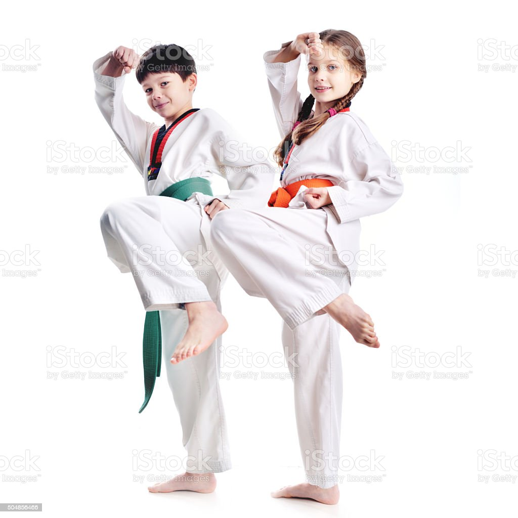Two children athletes martial art taekwondo training stock photo