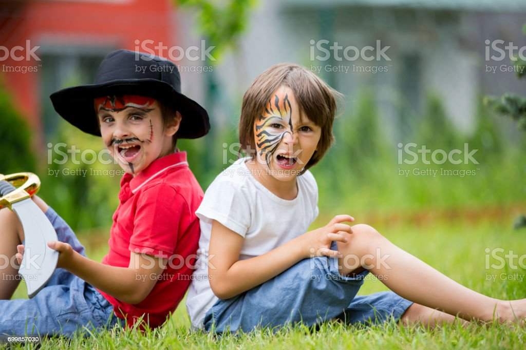 0224e3fddee8 Two Children Brothers Painted As Tiger And Pirate Playing Stock ...
